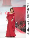 Small photo of New York, NY - February 8, 2018: Ginger Zee wearing gown by Lia Larrea walks runway for Red Dress 2018 Collection Fashion Show at Hammerstein Ballroom