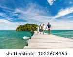 family walking on wooden...   Shutterstock . vector #1022608465