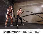 couple doing cardio exercise... | Shutterstock . vector #1022628169