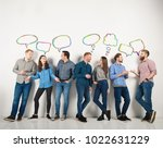 group of boys and girls speak... | Shutterstock . vector #1022631229