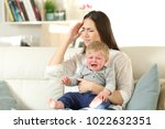 mother suffering and baby... | Shutterstock . vector #1022632351