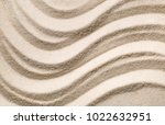 Stock photo zen sand garden with raked curved lines simplicity concentration or calmness abstract concept 1022632951