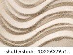 zen sand garden with raked... | Shutterstock . vector #1022632951