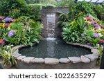 stone waterfall fountain in a... | Shutterstock . vector #1022635297