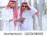arab business use tablet for... | Shutterstock . vector #1022638045