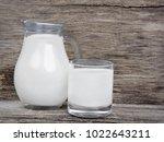 milk in glassware on rustic... | Shutterstock . vector #1022643211