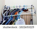 Small photo of The many weight of clothes on the deduct rack.