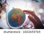 woman hand select destination... | Shutterstock . vector #1022653765