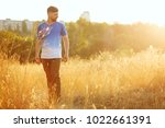a young man in a t shirt is...   Shutterstock . vector #1022661391