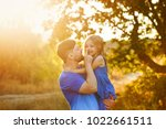 family time. the father holds...   Shutterstock . vector #1022661511