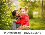 family time. the father holds a ...   Shutterstock . vector #1022661649