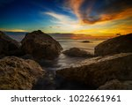 giant rock with sunrise | Shutterstock . vector #1022661961