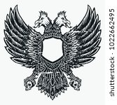 double headed eagle bird hand... | Shutterstock .eps vector #1022662495