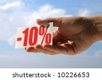 female hand holding sale card against sky, photo does not infringe any copyright - stock photo