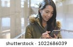 woman use of mobile phone at... | Shutterstock . vector #1022686039