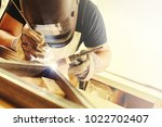 male in face mask welds with... | Shutterstock . vector #1022702407