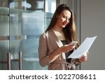 business woman with smartphone... | Shutterstock . vector #1022708611