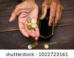 an elderly person holds the... | Shutterstock . vector #1022723161