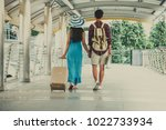 couple of lovers with valise... | Shutterstock . vector #1022733934