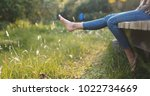 woman relax by the lake sitting ... | Shutterstock . vector #1022734669