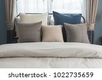 set of pillows on bed in modern ... | Shutterstock . vector #1022735659