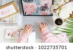 girl typing on laptop in bright ... | Shutterstock . vector #1022735701