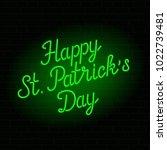 glowing neon sign   happy st.... | Shutterstock .eps vector #1022739481