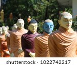 buddhist monk statues going to... | Shutterstock . vector #1022742217