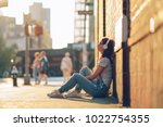 young woman with headphones... | Shutterstock . vector #1022754355