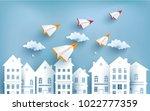 paper plane flying across town. ... | Shutterstock .eps vector #1022777359