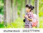 a girl travel in the forest. | Shutterstock . vector #1022777494