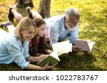 family is reading happily... | Shutterstock . vector #1022783767