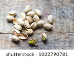 pistachios close up on a wooden ... | Shutterstock . vector #1022790781