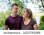 happy mother and son outdoors.... | Shutterstock . vector #1022792089