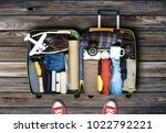 traveler's bag with clothes and ... | Shutterstock . vector #1022792221