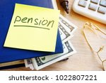 pension written on a stick and...   Shutterstock . vector #1022807221
