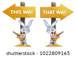 funny rabbit with a guitar near ... | Shutterstock .eps vector #1022809165