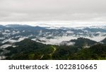 mountains filled with fog and... | Shutterstock . vector #1022810665