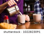 cocoa drink cooking | Shutterstock . vector #1022823091