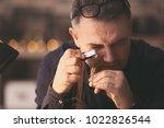 jeweler working in workshop ...   Shutterstock . vector #1022826544