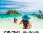 summer lifestyle traveler woman ... | Shutterstock . vector #1022829301
