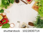 frame of fresh green salad  red ... | Shutterstock . vector #1022830714