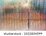 glass wet autumn background ... | Shutterstock . vector #1022834599