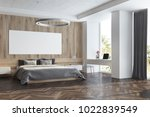 wooden bedroom interior with a... | Shutterstock . vector #1022839549