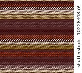 brown and beige rug woven... | Shutterstock .eps vector #1022844859