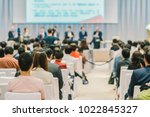 speakers on the stage with rear ... | Shutterstock . vector #1022845327