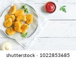 chicken nuggets and sauce on... | Shutterstock . vector #1022853685