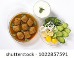 indian kofta curry with salad...   Shutterstock . vector #1022857591