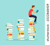 guy sits on books reading. flat ... | Shutterstock .eps vector #1022868409