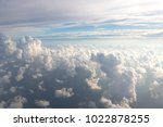 aerial view on clouds and blue...   Shutterstock . vector #1022878255